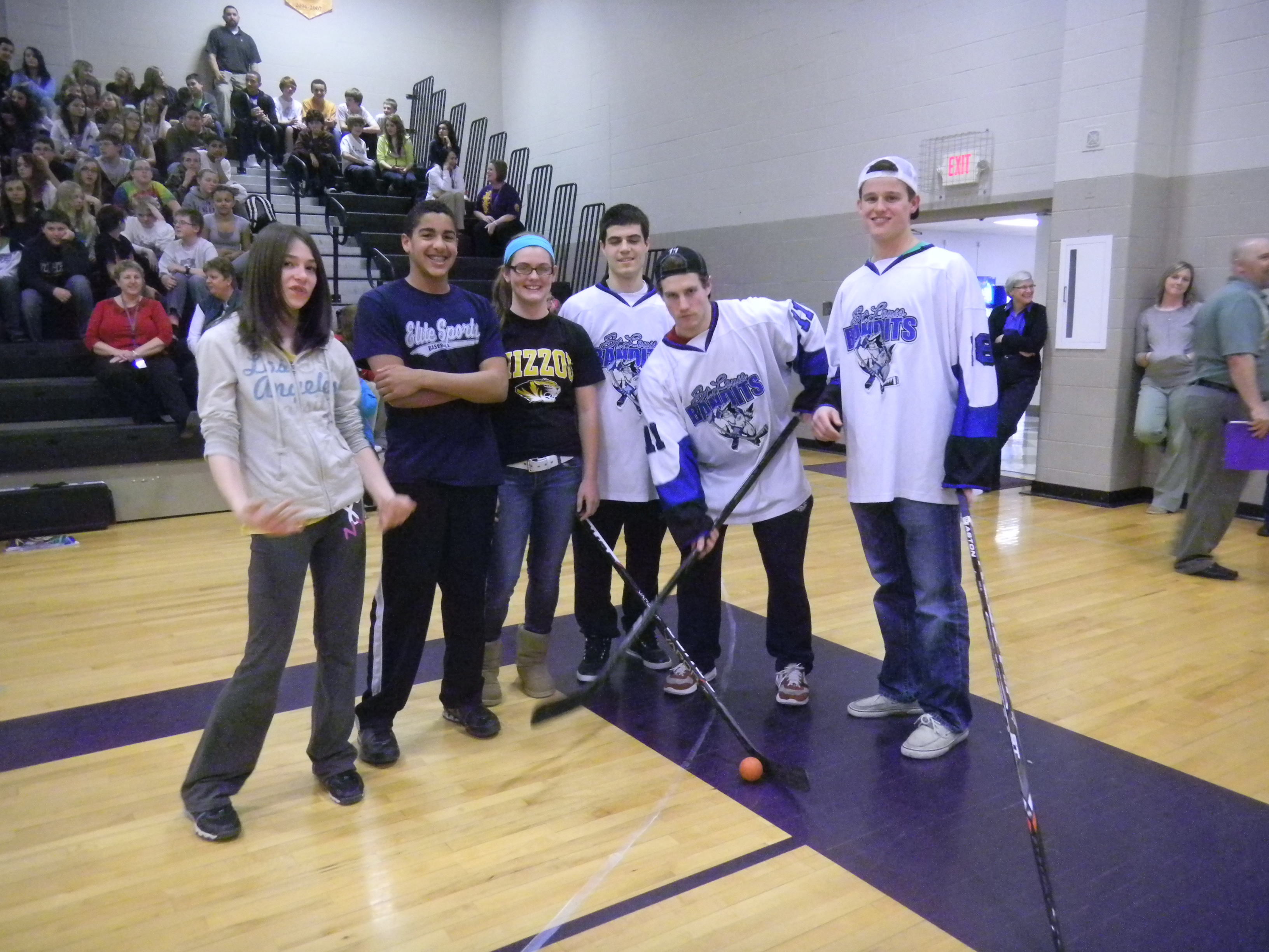 Teaming up with students to play some floor hockey!